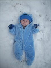 3 month old Blake making a snow angel