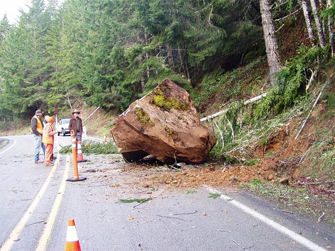 Giant boulder partially blocks road