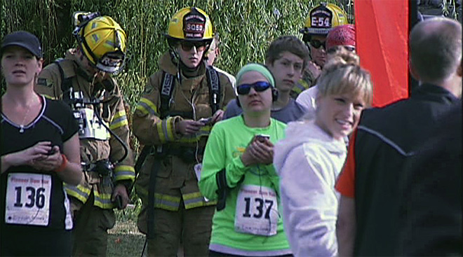 Firefighters in full gear join runners for the Pioneer Dam 10k