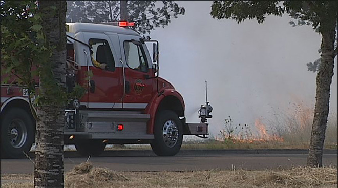 24 hours of fires - Brush fire closes W 11th Ave.