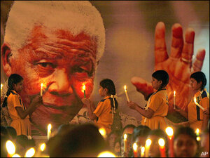 World mourns Mandela, struggles to find the words