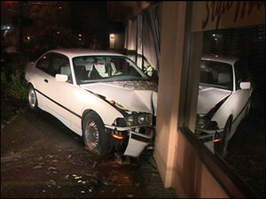 19-year-old driver spooked by cop car crashes into salon