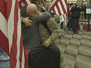 Crowd at airport welcomes troops home from Afghanistan