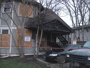 Neighbors rescue woman from second story of burning house