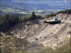 Obama surveys scene of sadness, death at mudslide