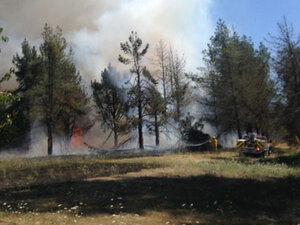 Brush fire closes roads near Creswell