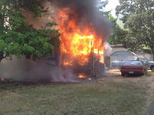 Neighbors evacuated as crews battle Roseburg house fire