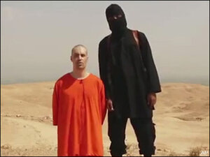 Islamic State militants behead American, threaten another