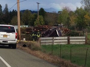 2 dead in head-on crash with log truck