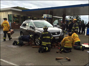 Manager run over at Bellevue gas station, trapped under SUV