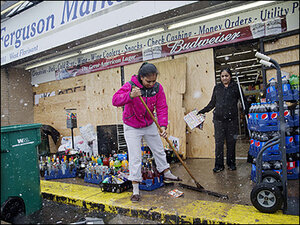 Ferguson residents clean up, hope for calm night