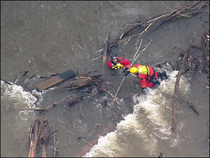Woman rescued from Cedar River, 5-year-old boy still missing