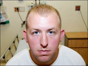 U.S. clears officer in Ferguson case, criticizes police force