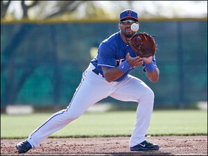 Photos: Seahawks QB Wilson suits up for Rangers baseball practice