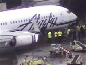 Panicked 911 call from belly of Alaska 737: 'I'm inside a plane!'