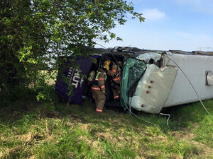 Bus rolls on I-5 south of Woodburn, 3 taken to the hospital