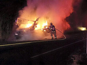 Fire consumes RV, spreads to nearby brush
