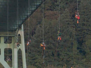 Protesters drop from Portland bridge to block Shell oil ship