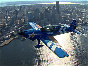 Photos: Former KVAL anchor soars over Seattle in stunt plane