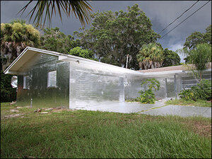 Photos: Florida man stumps neighbors by covering home in aluminum foil