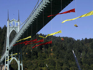 Shell ship turns back from activists suspended from bridge