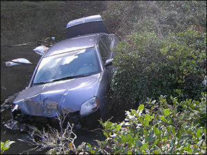 DUII driver hits power pole, crashes into creek on Yaquina Bay Rd.