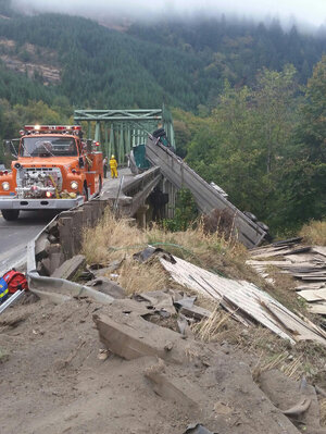 Semi trailer dangles off Hwy 38 bridge after crash near Reedsport