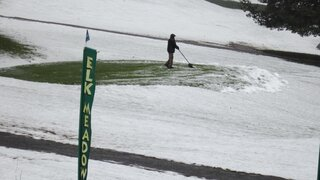 Getting the 9th green ready