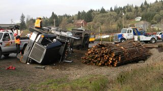 Log Truck Rolls in Philomath