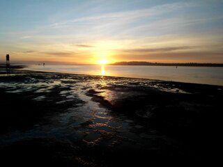 SUNSET AT LOW TIDE ON COOS BAY