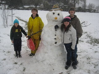 Cousins Brave Weather to Make Snow Man