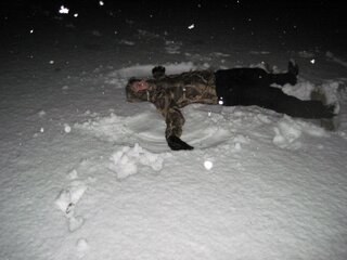 Clint making a snow angel on the beach