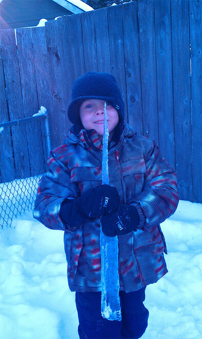 Photo from Julie Ryon - Atticus age 6 found this real icicle_he was so excited he had to put it in the freezer