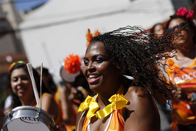 they take part in a curl power street party encouraging Afro-Brazilian ...