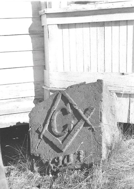 Keystone of Masonic Lodge salvaged from ruins of fire