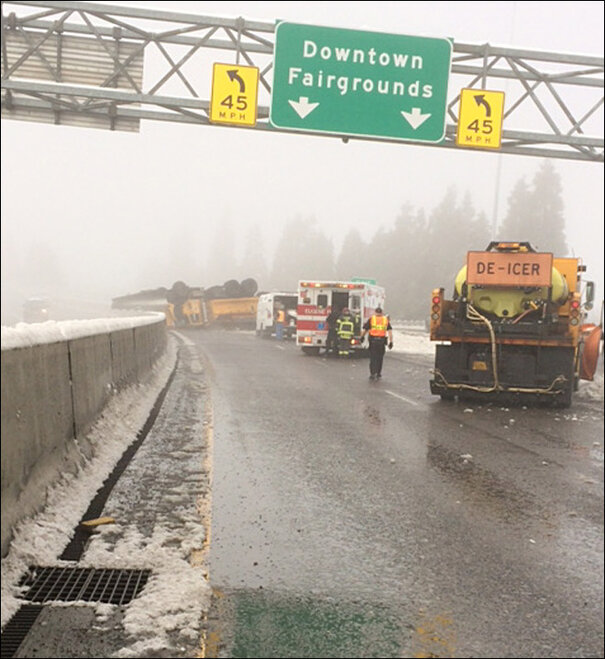 Snow-plow-flips-on-Highway-105---1