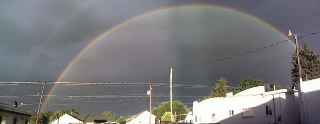 Clouds can't hide double rainbow