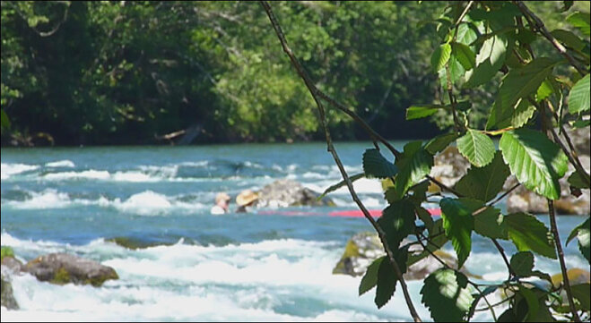 Canoe capsizes in the river