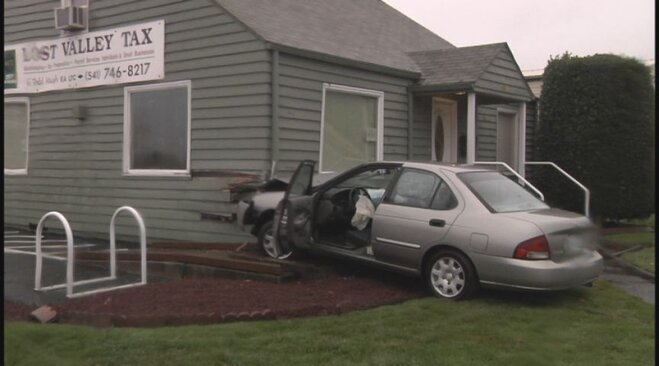 Man runs after crashing stolen car into building
