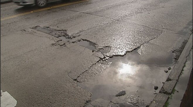 Weather whips up new crop of potholes (2)