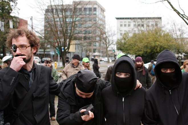 Occupy Eugene 'Ninjas' march on banks