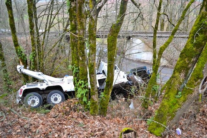 Tow truck crashes on way to get stuck truck