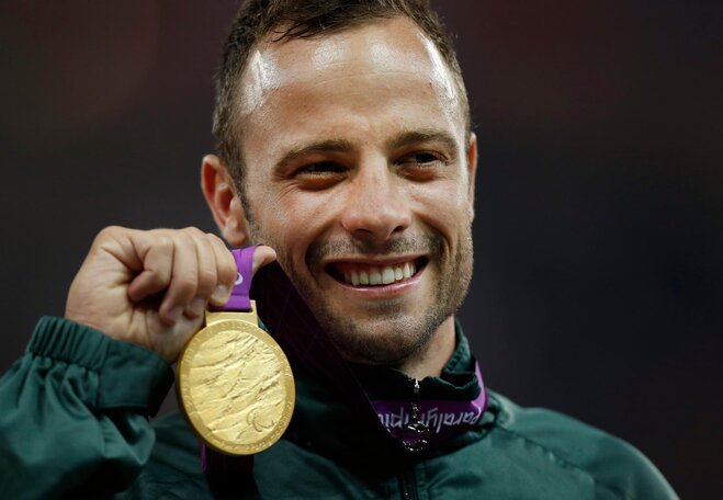 Amputee Olympic star Pistorius charged in slaying