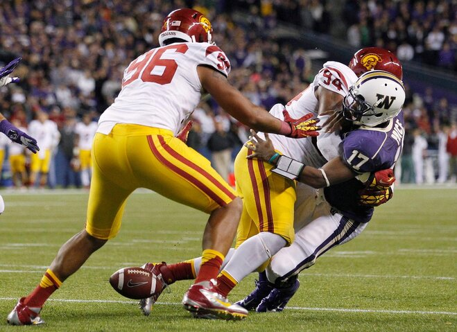 Redd, defense leads No. 11 USC past Huskies 24-14