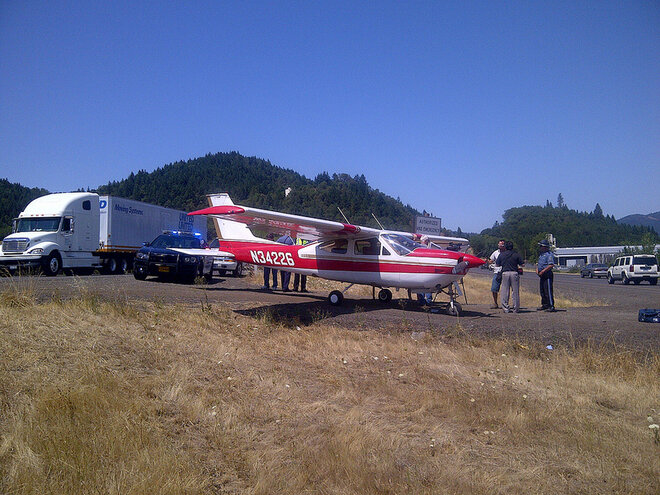 Airplane lands on I-5