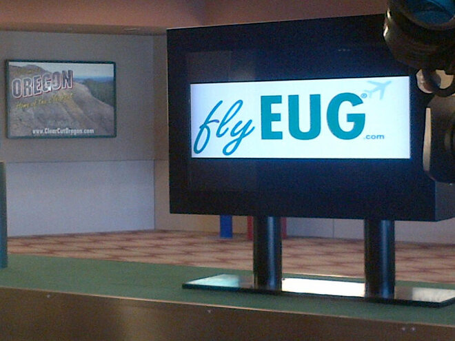 Why is this ad OK at airport in Eugene but not Portland?