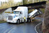 Walmart truck gets stuck under overpass