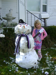 Gracie's Snowman is as tall as She Is!