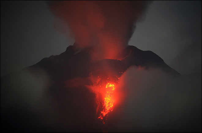 Indonesia volcano erupts again; kills at least 14