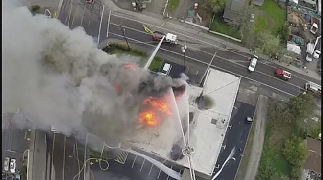 Amateur photographer films furniture store fire from air